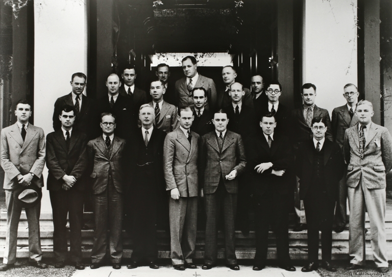 Federal Parliamentary Press Gallery, December 1936. Absent: J A Alexander (Melbourne Herald), S K Mitchell (Age), R B Leonard (Melbourne Sun Pictorial), F B Tremearne (Australian United Press). Back row: K Murphy (Melbourne Herald), E H Cox (Argus), R I Douglas (Press Liason Officer), A Clementson (West Australian), L R McLennan (Argus). Middle row: E H Brenton (Melbourne Herald), G Chinner (Adelaide Advertiser), D K Rodgers (Labor Daily), M Byrne (Sydney Sun), E J Hewitt (Australian United Press), G Imai (Asahi, Tokio), J M Stanley (Sydney Telegraph), L Palmer (Canberra Times). Front row: R R Nall (Sydney Morning Herald), E S Bell-Smith (Australian United Press), N Murray (Sydney Sun), W F Whyte (Federal News Service), O G Olsen (Sydney Sun, Gallery President), B J Anderson (Melbourne Herald), L F McDonnell (Australian United Press), H S Innes (Sydney Morning Herald), R Maley (Sydney Morning Herald). Photo: A Collingridge.