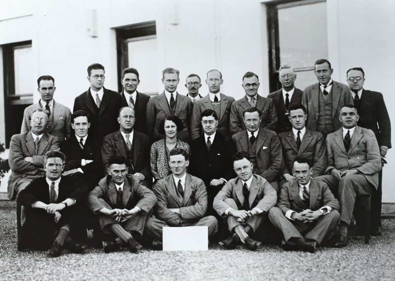 Federal Parliamentary Press Gallery, May 1931. Back row: M Byrne (Australian United Press), S Speight (Sydney Morning Herald), E C O'Loughlin (Government Publicity Officer), O Olsen (Sydney Sun), U R Ellis (CP Publicity Officer), J Hewitt (Australian United Press), Warren Denning (Argus), W F Whyte (Canberra Times), F Percival (Sydney Morning Herald), L R McLennan (Argus). Middle row: C F M Burr (Australian United Press), Alan Fraser (Sydney Sun), F Tremearne (Canberra Times), Miss L Denholm (Sydney Morning Herald), H S Innes (Sydney Morning Herald, Press Gallery President), Neville Smith (Melbourne Herald), J M Stanley (Sydney Daily Telegraph0, S K Mitchell (Age). Front row: M G T Woods (Sydney Sun), R Hughes Jones (Australian United Press), L F Fitzgerald (Sydney News Pictorial), H W Eather (Melbourne Herald), J R W Taylor (Sydney Morning Herald. Absent: E H Brenton (Melbourne Herald).
