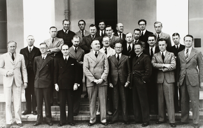 Federal Parliamentary Press Gallery, December 1938. Absent: B J Anderson (Melbourne Herald), L F McDonnell (Brisbane Telegraph), G Chinner (Adelaide Advertiser), E H Cox (Argus). Back row: E H Brenton (Sydney Telegraph), M MacCullum (Sydney Morning Herald), J E Mitchell (Sydney Morning Herald), F B Tremearne (Australian United Press), K S Schapel.