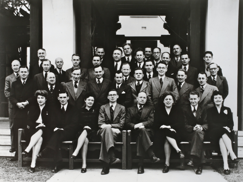 Federal Parliamentary Press Gallery, 1945. Back row: L Leck (Sydney Morning Herald), W T Knox (Sydney Telegraph), A W Spurr (Argus), H Tilley (Australian Associated Press, F Fitzgerald (Argus). Third row: J Corbett (Argus), J Hill (Melbourne Sun), N Prisk (Adelaide News), F Primrose (Sydney Morning Herald) W Morgan (Australian Broadcasting Commission), G Holland (Age) W Jenkings (Mirror), K Power (Mirror), J Commins (Australian Broadcasting Commission), C Halliday (Sydney Morning Herald), J Fingleton (Radio Australia), J Ashton (Sydney Sun), G Slater (Australian United Press), B Netterfield (Sydney Telegraph). Second row: D Pilcher (Age), W Mountjoy (Sydney Tribune), G Bentley (Sydney Sun), A Campbell (Australian United Press) L Teese (Australian United Press), K Moses (Sydney Telegraph, K Mattingley (Melbourne Herald), S W Stephens (Adelaide Advertiser), H Sholl (Sydney Morning Herald). Front row: Miss S Lambert (Australian Broadcasting Commission), J Allsopp (Australian United Press), Miss L Craig (Sydney Telegraph), W Bissell (Sydney Sun), N V Kearsley (Brisbane Telegraph, Gallery President), Miss N Musgrave (Mirror), A D Reid (Sydney Sun), Miss K Coyne (Australian United Press).
