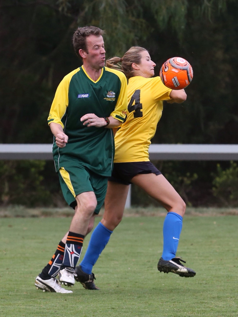 The Coalition's Dan Tehan and Channel Seven's Marija Jovanovic during the Press Gallery v Pollies soccer match in Canberra on Wednesday 4 March 2015. Photo: Andrew Meares