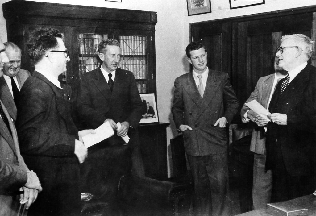 Press conference with the leader of the Federal Parliamentary Labor Party, Dr H. V. Evatt (circa 1953). L to R: Frank Jost (Australian Broadcasting Commission), Bernie Freedman (Melbourne Argus), Jack Commins (Australian Broadcasting Commission), Harry Holgate (Sydney Morning Herald), Stan Stephens (Adelaide Advertiser), Dr H. V. Evatt.