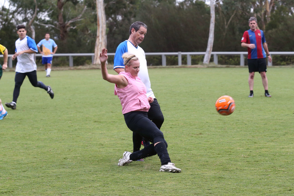 New Ltd's Tory Shepherd clears Senator Stephen Conroy during the Press Gallery v Pollies football match in Canberra on Wednesday 4 March 2015. Photo: Andrew Meares