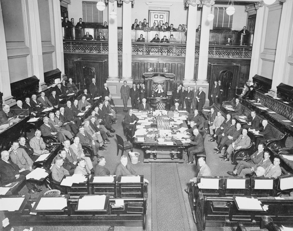 The last day of sitting of the House of Representatives in the Victorian Parliament House, 24 March 1927. Once again the members of the Press Gallery managed to get themselves in this photo of Lower House politicians.