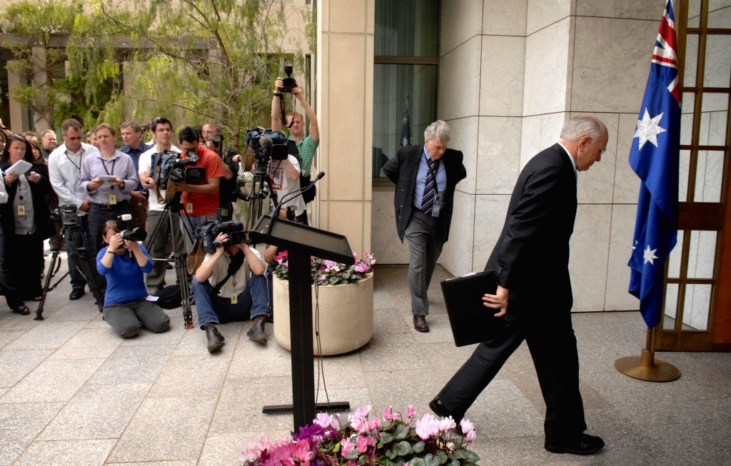 John Howard leaves the PM's courtyard after calling the 2007 election in which he would lose office and his own seat. Photo: Ray Strange, News Corp.