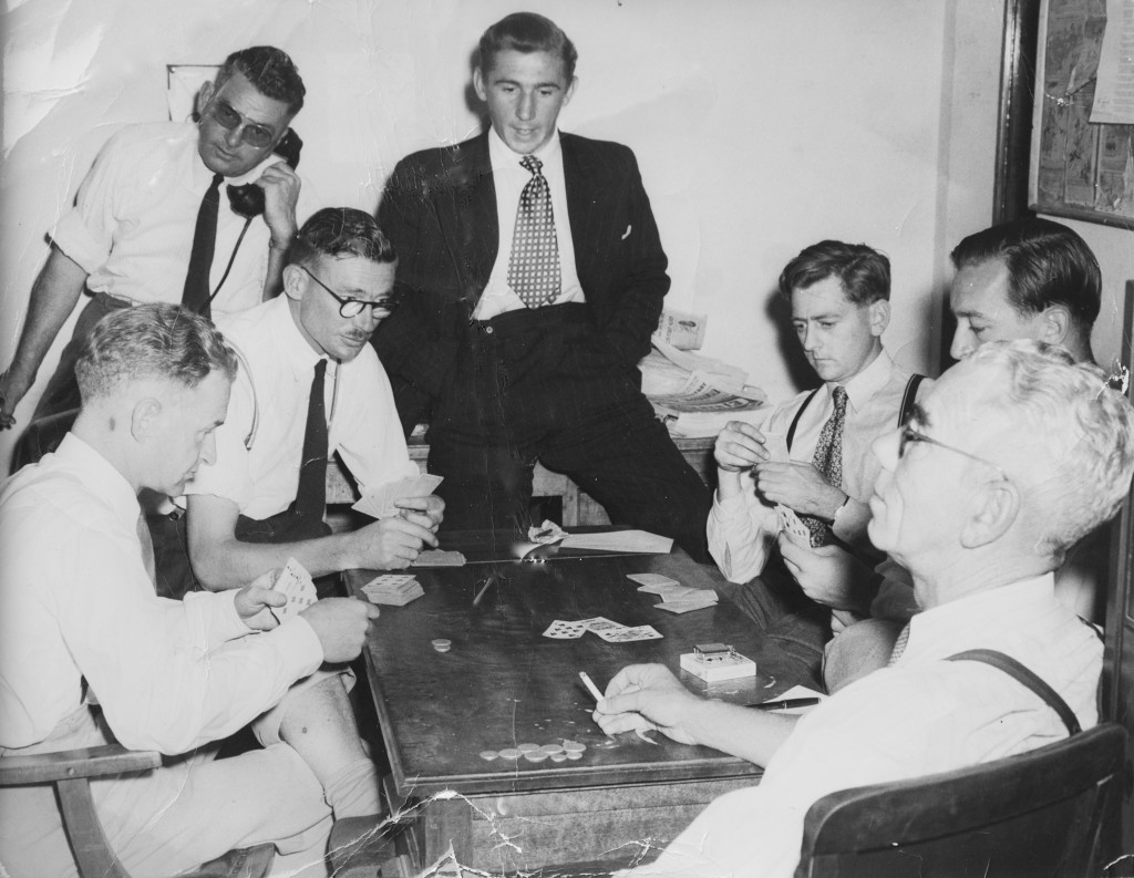 A group of journalists playing cards in the Press Gallery common room, circa 1950. The coins on the table suggest they were playing for keeps. Photo courtesy of the Reid family collection.