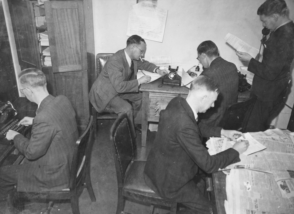 A typical newspaper office in the Press Gallery at Old Parliament House, where smoking was allowed and only two fingers were needed to type out a story.
