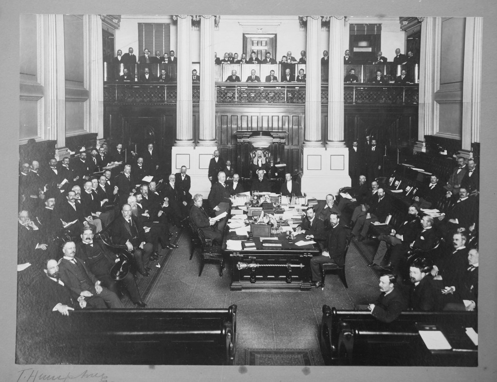 This photo is of the first federal budget in 1901 and is the oldest known photo containing the members of the Federal Parliamentary Press Gallery. They are seated in the gallery above the Speaker's chair. The picture also has in it one current and five future Prime Ministers – Barton, Deakin, Cook, Reid, Watson and Hughes.