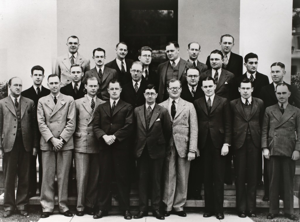 Federal Parliamentary Press Gallery, December 1934. Back row: S K Mitchell (Age), E M Cox (Argus), G Wade (Canberra Times), D Speight (Sydney Morning Herald), R I Douglas (Official Publicity Officer), J Hewitt (Australian United Press), R B Leonard (Star), V Wright (Sun), L Basser (Telegraph). Front row: F Tremearne (Australian United Press), D Gardiner (Melbourne Sun), O G Olsen (Sydney Sun), M Stanley (Telegraph), H S Innes (Sydney Morning Herald), J A Alexander (Melbourne Herald), J Anderson (Melbourne Herald), L McDonnell (Australian United Press), M Byrne (Star), H A Standish (Sydney Morning Herald), F Folkard (Sydney Sun), M M Threlfall (Sydney Morning Herald), L R McLennan (Argus), D K Rodgers (Labor Daily).