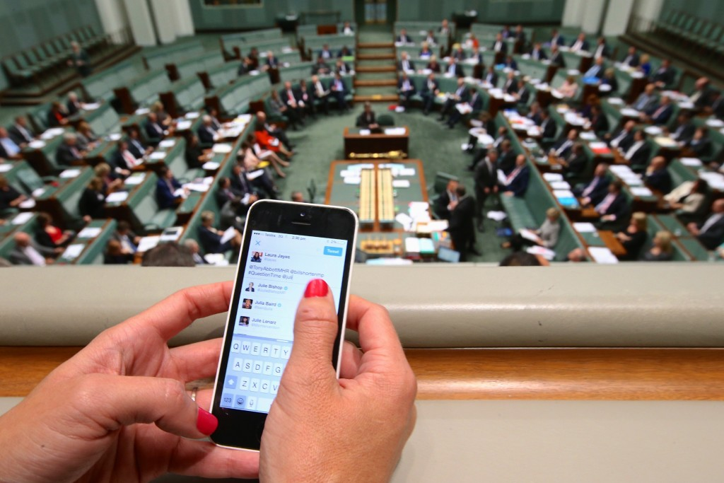 Sky News' Laura Jayes Tweeting during Question Time, Thursday 28 May 2015. Photo: Andrew Meares.