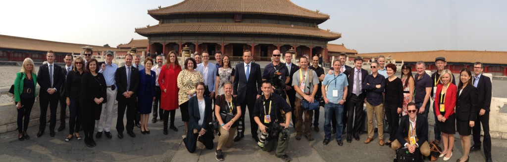 Prime Minister's North Asia Trip, Forbidden City, Beijing, April 12, 2014. This photo includes media, Prime Ministerial and diplomatic staff. Back row (left to right): Sue Hollins, Nathan Babbs, Timothy White, Karina Soltyszewski, Andrew Robertson, Gemma Iafrate, Dr Ian Watt, Josh Frydenberg MP, Dr Mark Higgie, Frances Adamson, Michael Pachi, Peta Credlin, Jane McMillan, Lindsay Youman, Adrian Barrett, Josh Wilson, Nicole Chant, Prime Minister Tony Abbott, Chris Rouse, Graeme Brindley, Paul Atkinson, Lynette Wood (obscured), Phil Coorey, Andrew Probyn, Gavin Dimond, Andrew Shearer, Mark Kenny, Dr Charles Howse, Dr Margot McCarthy, May-Lea Ling, Simon Benson, Geoff Crane, Brooke Corte, Yicen Wang, David Crowe. Front Row (left to right): Kate Rutherford, Kym Smith, Alex Ellinghausen, Nick Perry. Taken on an iPhone 4S by both Mark Kenny (10th from right) and David Crowe (extreme right) in panorama mode. The swap-over point between the two photographers was at Geoff Crane (4th from right), as shown by the fact he has two left ears.