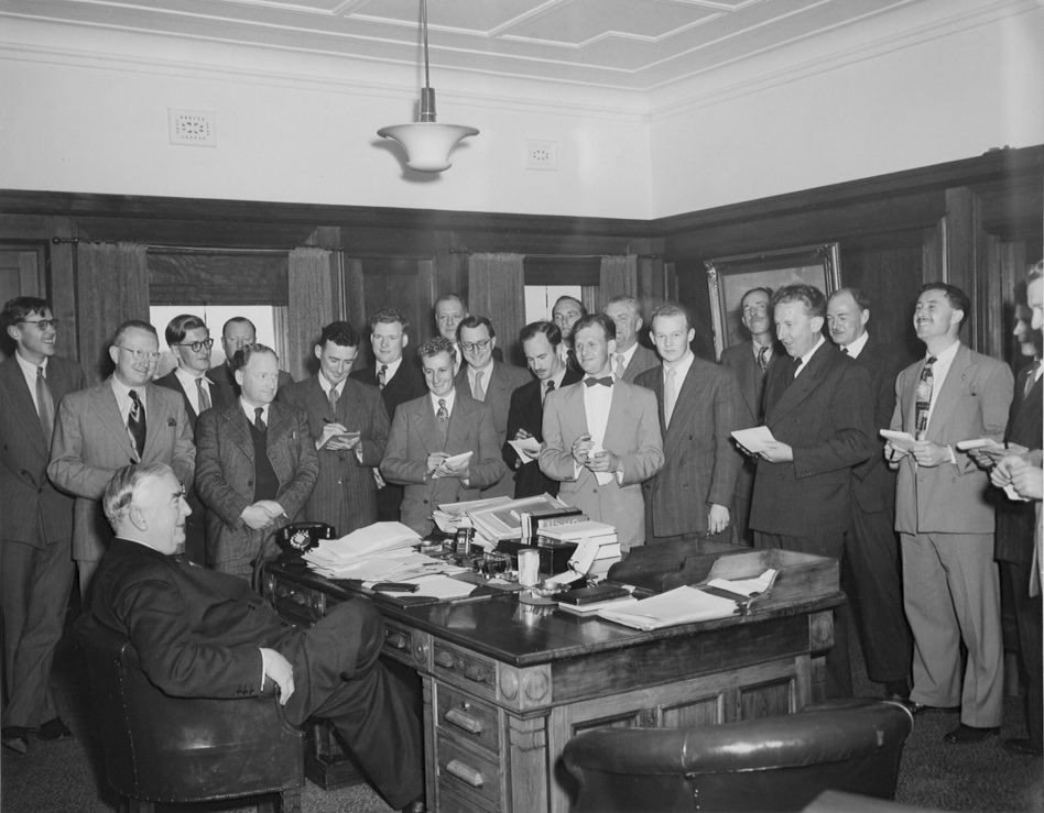 """Presented to the Federal Parliamentary Press Gallery by the Right Honourable R.G. Menzies, October 1951 and signed """"Who misreported me, anyhow? Robert Menzies 1951"""". Left to right: Messrs. Elgin Reid (Courier Mail), Frank Chamberlain (Sun Pictorial), Hal Myers (Sydney Morning Herald), Ian Fitchett (The Age), Kevin Power (Daily Mirror), Jack Allsopp (Australian United Press), Gavin Handley (Sydney Morning Herald), Les Teese (Australian United Press), Irvine Douglas (Sydney Morning Herald), Stan Hutchinson (Sun Pictorial), Charles Nicol (Menzies' Press Secretary), John Bennetts (Melbourne Herald), Fred Coleman (Argus), R Maley (Argus), Brian Wright (Argus), Jack Kenny (Daily Telegraph), Jack Commins (Australian Broadcasting Commission), Harold Cox (Melbourne Herald), Bob Logue (Daily Mirror), Gordon Burgoyne (Australian Broadcasting Commission), Alan Reid (Sydney Sun). The original hangs on the wall of the National Press Club, Canberra."""