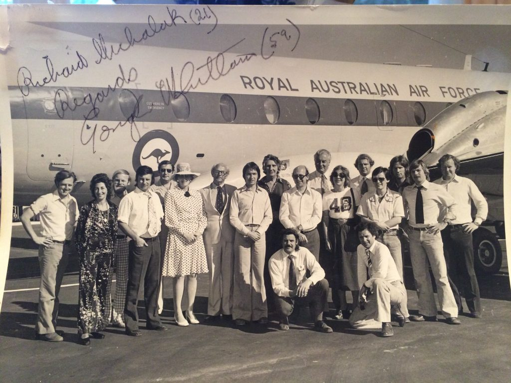 Photo depicting 20 people standing in front of a Royal Australian Air Force jet. The photo is signed by PM Gough Whitlam.