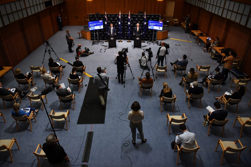 A press conference with PM Scott Morrison where the assembled media are all spaced apart from each other and the PM.